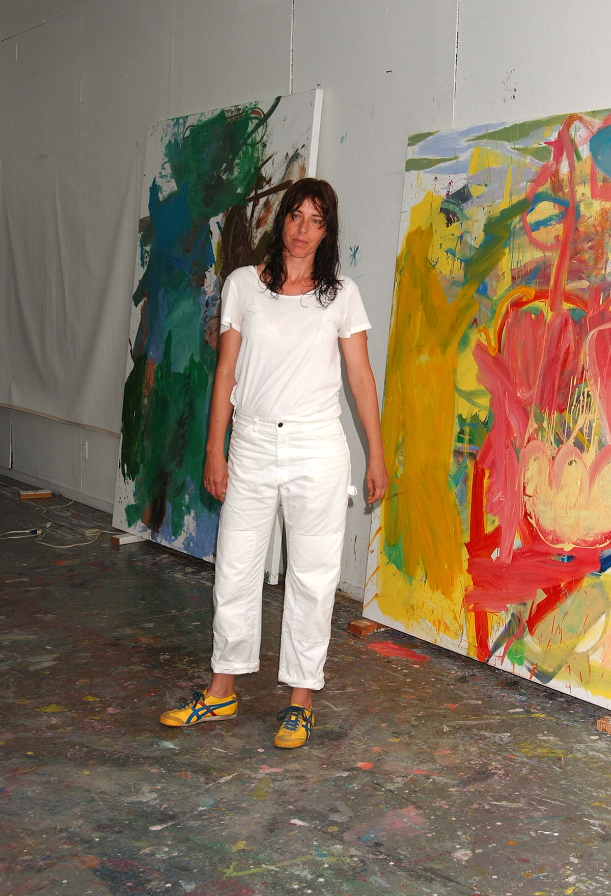 Artist Anke Weyer with her paintings during her artist-in-residency at the former home/studio of artist Elaine de Kooning in East Hampton, New York. After Elaine de Kooning died the sculptor John Chamberlain bought the property and worked here.