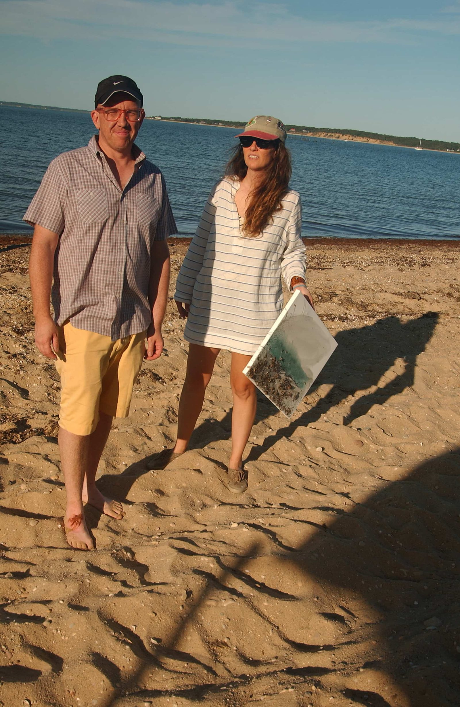Artists Scott Reeder and Laura Owen (L-R) participate with the Beach Painting Club at Sammy's Beach in East Hampton, New York.